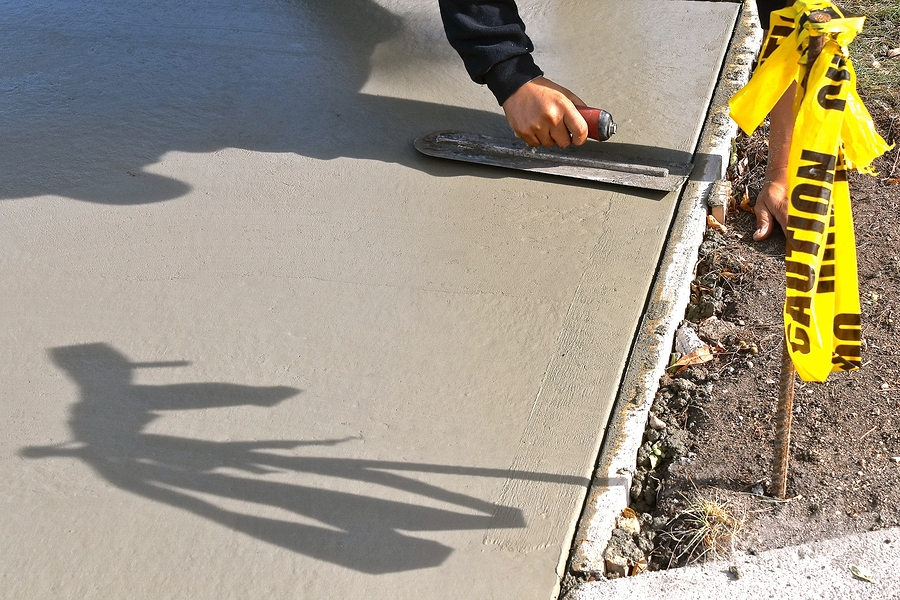 concrete expert working on driveway
